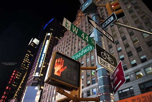 Exclusive Escorted Group Trip to New York from 15 - 21 November, 2019. Sign post and pedestrian crossing signal New York City. Indicates Broadway, one way, stop hand signal etc..